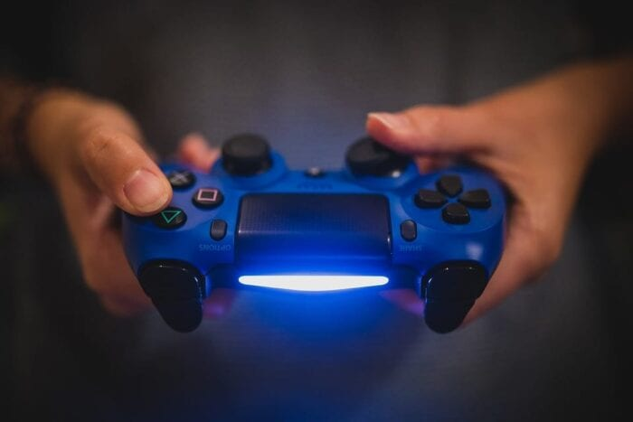 person holding a dualshock 4