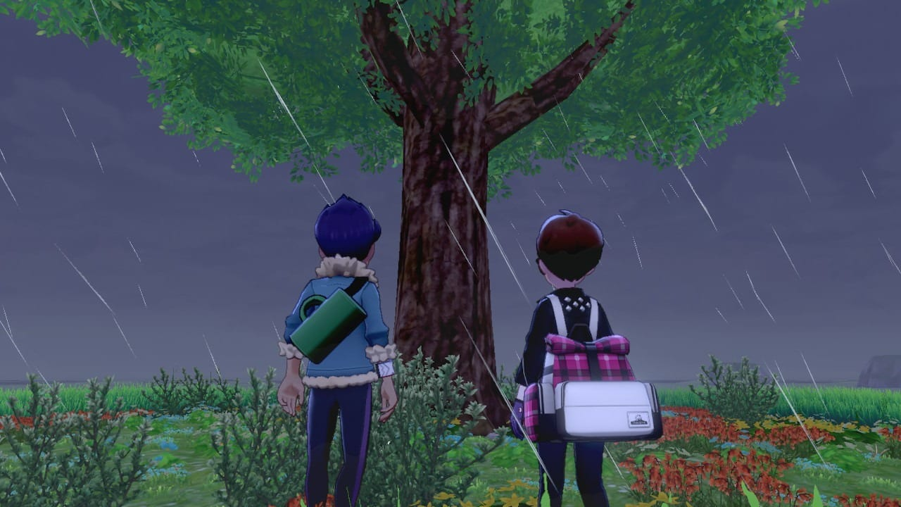 Hop and player standing by a tree