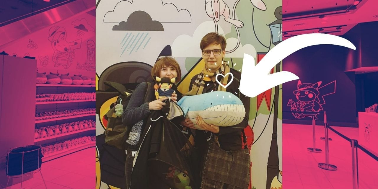 Author next to a huge Wailord plush at the pop-up pokemon centre