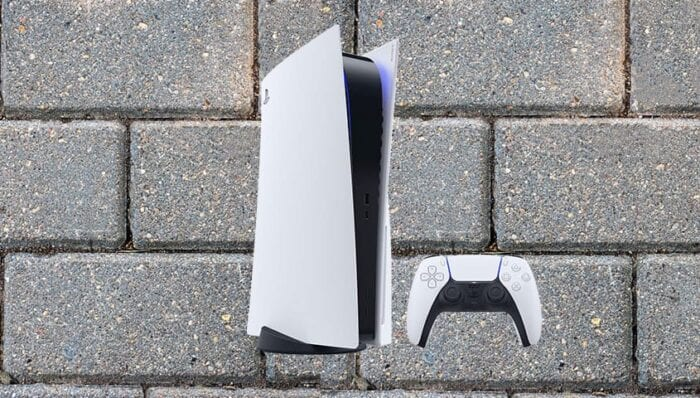 PS5 console on a brick background